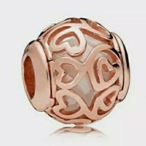 Pandora rose gold Hearts filigree charm.